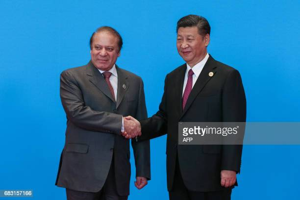 China's President Xi Jinping shakes hands with Pakistan's Prime Minister Muhammad Nawaz Sharif during the welcome ceremony for the Belt and Road...
