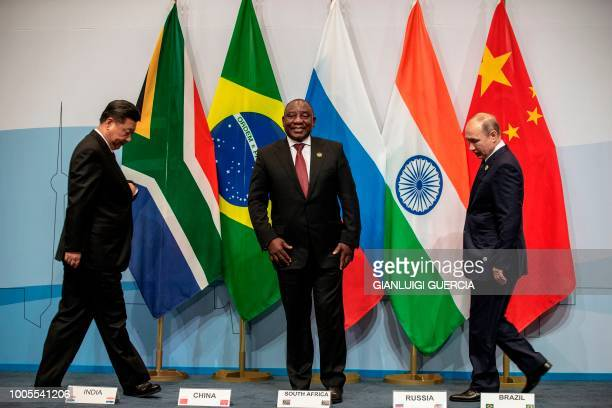 China's President Xi Jinping, South Africa's President Cyril Ramaphosa and Russia's President Vladimir Putin arrive to pose for a group picture...
