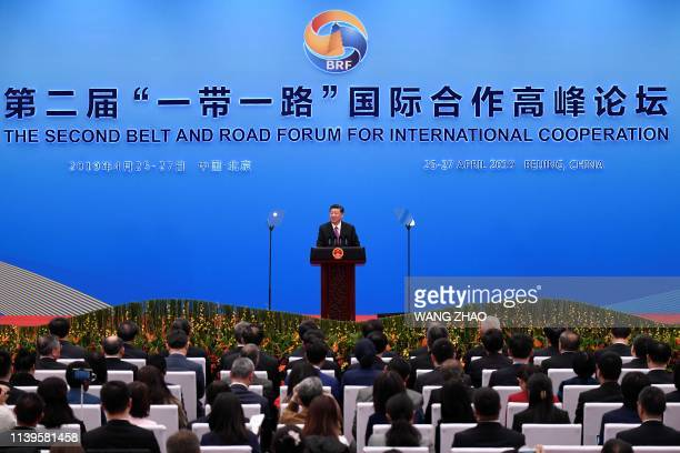China's President Xi Jinping speaks at a press briefing at the end of the final day of the Belt and Road Forum at the China National Convention...