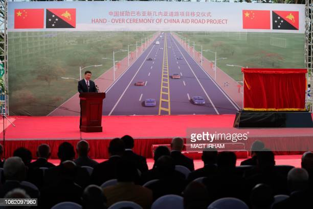 China's President Xi Jinping speaks during the opening ceremony of the ChinaAid PNG Independence Boulevard Project in Port Moresby on November 16...