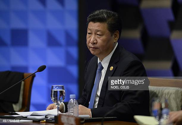 China's President Xi Jinping takes part in the leaders' 'Retreat 1' at the annual 21member AsiaPacific Economic Cooperation summit in Manila on...