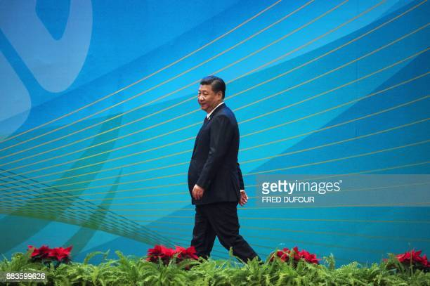 China's President Xi Jinping takes the stage during the opening ceremony of the 'CPC in dialogue with world political parties highlevel meeting at...