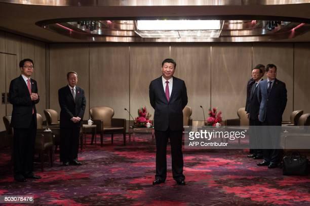 TOPSHOT China's President Xi Jinping waits to meet with Hong Kong's chief executive Leung Chunying at a hotel in Hong Kong on June 29 2017 Xi arrived...