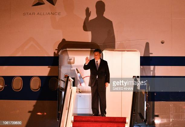 China's President Xi Jinping waves as he leaves his plane upon arrival at Port Moresby International Airport on November 15 ahead of Asia-Pacific...