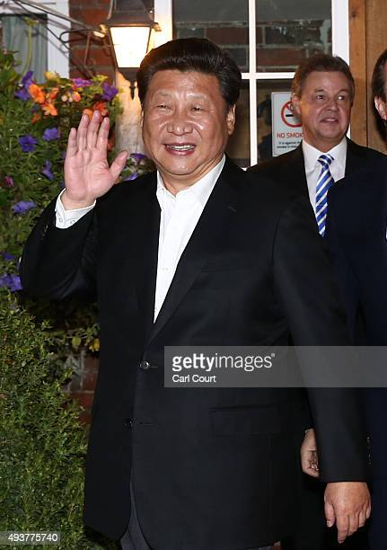 China's president Xi Jinping waves as he leaves The Plough pub on October 22 2015 in Princes Risborough England The President of the People's...