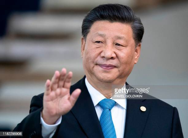 China's President Xi Jinping waves the press before the 11th BRICS Summit at the Itamaraty palace on November 14, 2019 in Brasilia, Brazil. -...