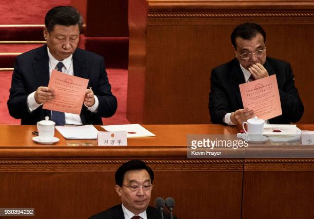 China's President Xi Jinpingleft and Premier Li Keqiang right examine their ballots during a session of the National People's Congress prior to...