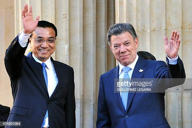 China's Prime Minister Li Keqiang and Colombian President Juan Manuel Santos wave during a welcoming ceremony at the Narino presidential Palace in...