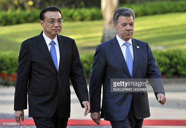 China's Prime Minister Li Keqiang and Colombian President Juan Manuel Santos walk during a welcoming ceremony at the Narino presidential Palace in...