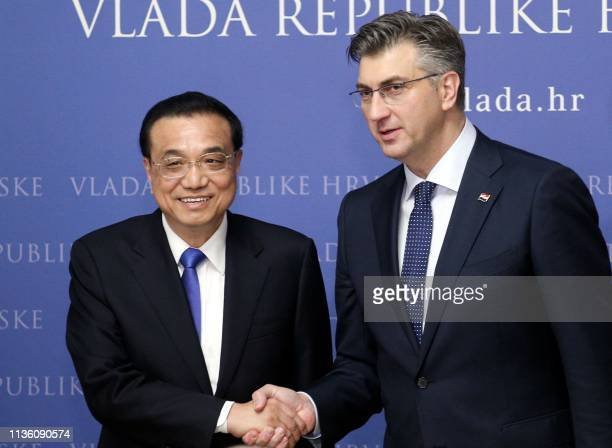 China's Prime Minister Li Keqiang and his Croatian counterpart Andrej Plenkovic shake hands following a joint press conference following their...