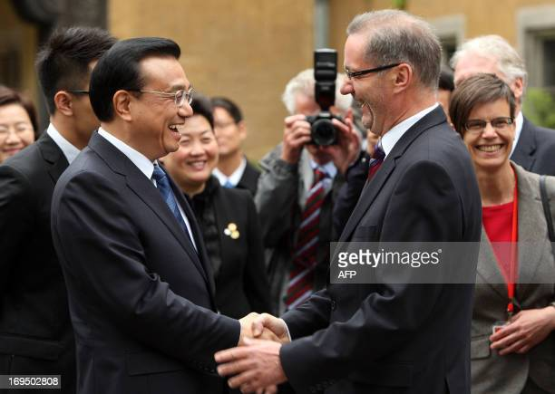 China's Prime Minister Li Keqiang and Matthias Platzeck Prime Minister of the German federal state of Brandenburg shake hands as they meet at the...