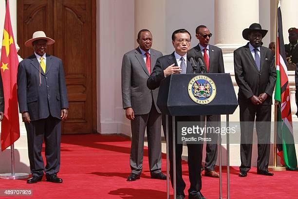 China's Prime Minister Li Keqiang joined by President Yoweri Museveni of Uganda Kenyan President Uhuru Kenyatta Paul Kagame of Rwanda and South...