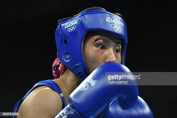 China's Ren Cancan fights Canada's Mandy Marie Brigitte Bujold during the Women's Fly Quarterfinal 2 match at the Rio 2016 Olympic Games at the...