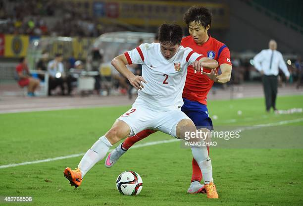 China's Ren Hang vies with South Korea's Lee Yongjae during the men's East Asian Cup football match between China and South Korea at the Sports...