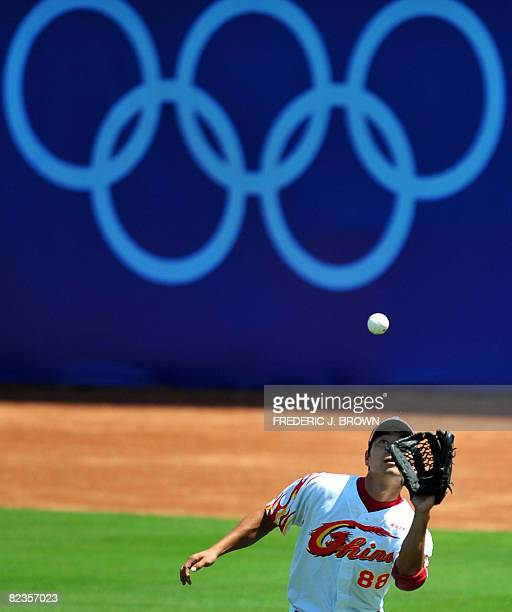 China's rightfielder Feng Fei makes the catch off a hit by out Taiwan's Chiang Chih-Hsien in the top of the fourth inning in their men's preliminary...