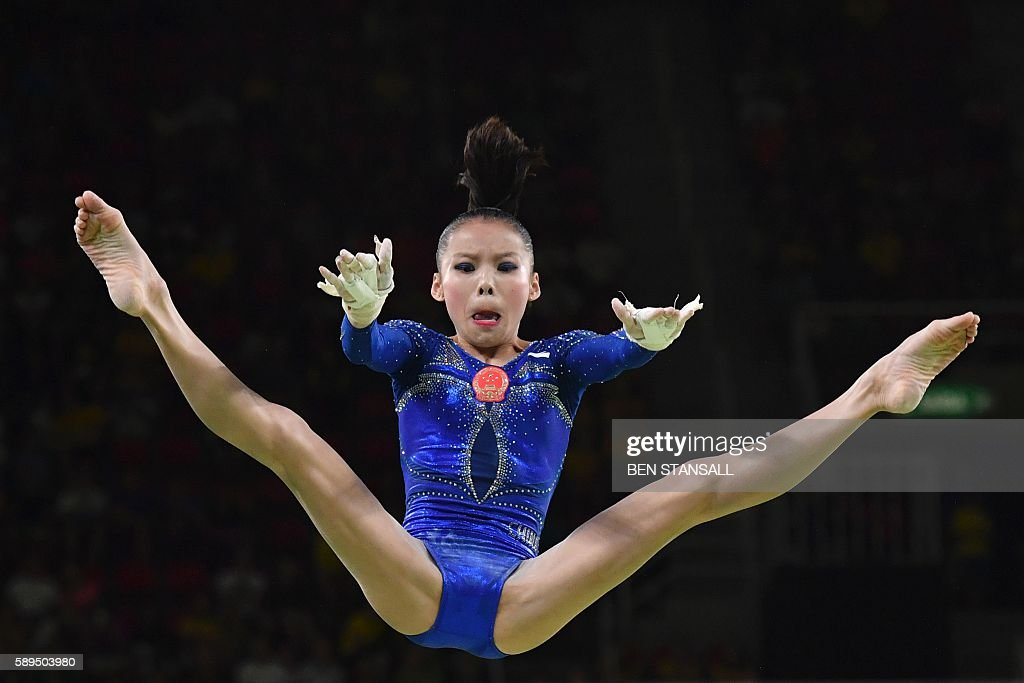 TOPSHOT - China's Shang Chunsong competes in the women's uneven bars event final of the Artistic Gymnastics at the Olympic Arena during the Rio 2016 Olympic Games in Rio de Janeiro on August 14, 2016. / AFP / Ben STANSALL