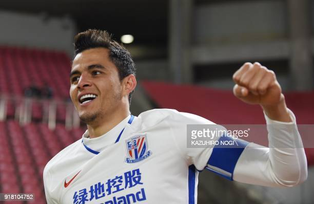 China's Shanghai Shenhua player Giovanni Moreno celebrates his goal during a group stage football match against Japan's Kashima Antlers in Kashima,...