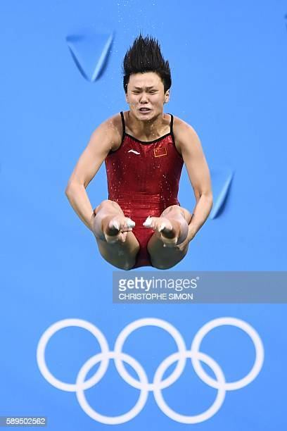 TOPSHOT China's Shi Tingmao competes in the Women's 3m Springboard Final during the diving event at the Rio 2016 Olympic Games at the Maria Lenk...
