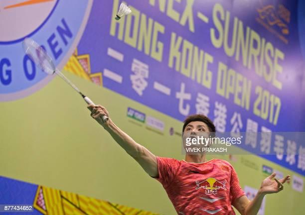 China's Shi Yuqi hits a shot against Denmark's HansKristian Vittinghus during their first round men's singles match at the Hong Kong Open badminton...