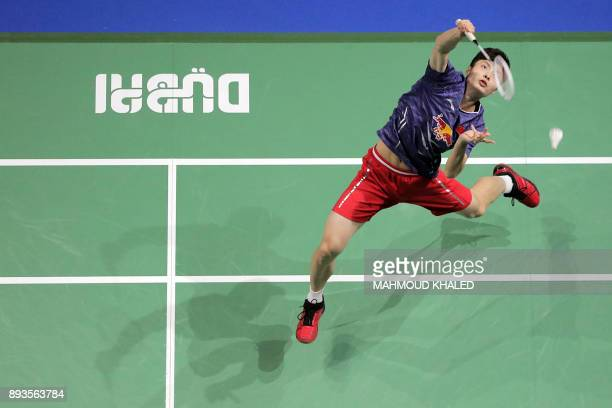 China's Shi Yuqi returns a shot to India's Kidambi Srikanth during the third day of the Dubai Badminton World Superseries Finals in Dubai on December...