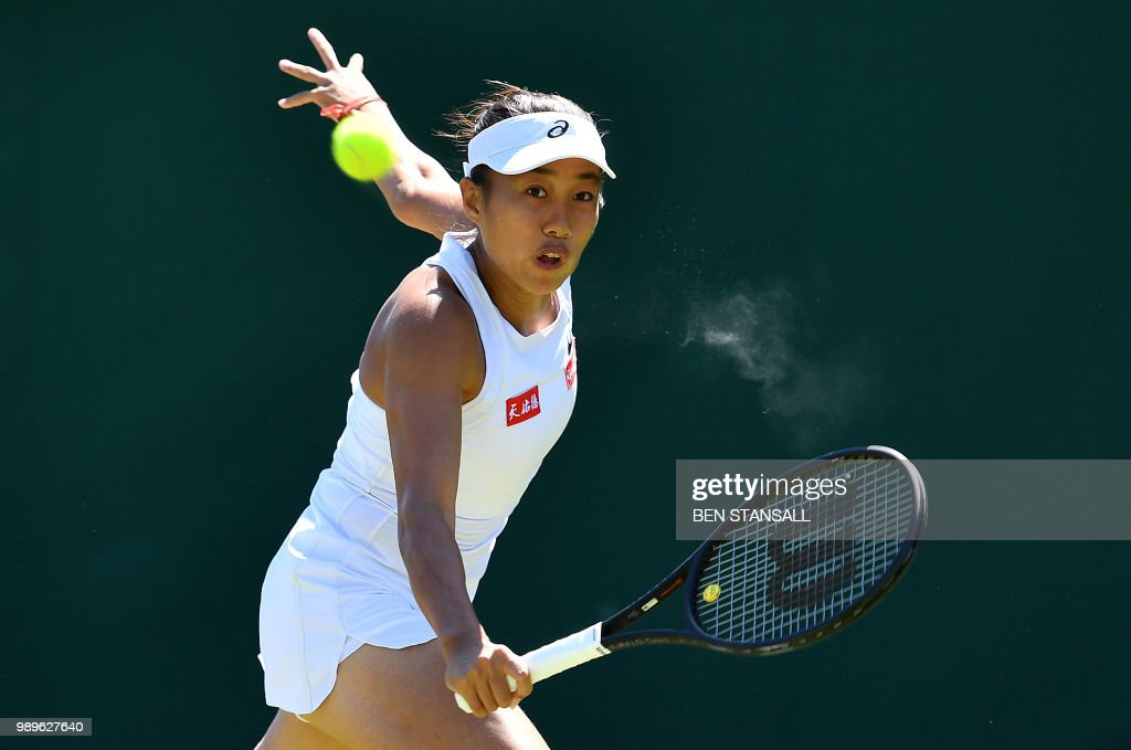 China's Shuai Zhang returns against Germany's Andrea Petkovic during their women's singles first round match on the first day of the 2018 Wimbledon Championships at The All England Lawn Tennis Club in Wimbledon, southwest London, on July 2, 2018. (Photo by Ben STANSALL / AFP) / RESTRICTED