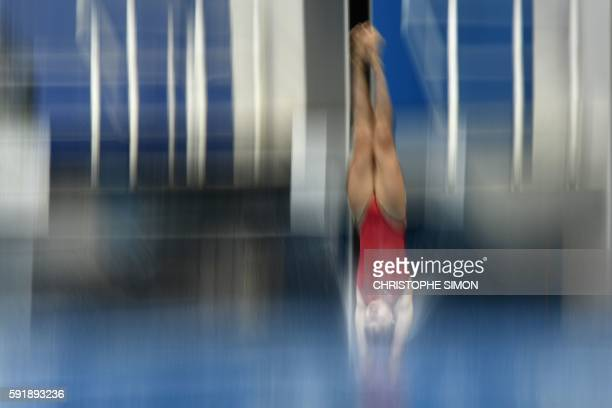 China's Si Yajie takes part in the Women's 10m Platform Final during the diving event at the Rio 2016 Olympic Games at the Maria Lenk Aquatics...