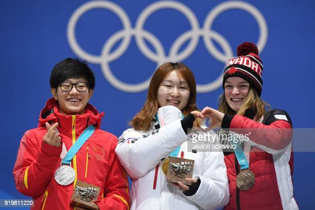China's silver medallist Li Jinyu, South Korea's gold medallist Choi Minjeong and Canada's bronze medallist Kim Boutin pose on the podium during the...