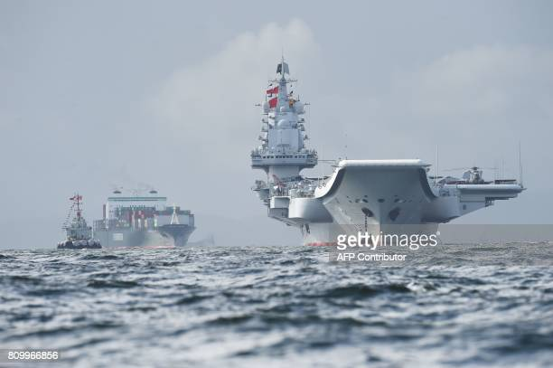 TOPSHOT China's sole aircraft carrier the Liaoning arrives in Hong Kong waters on July 7 less than a week after a highprofile visit by president Xi...