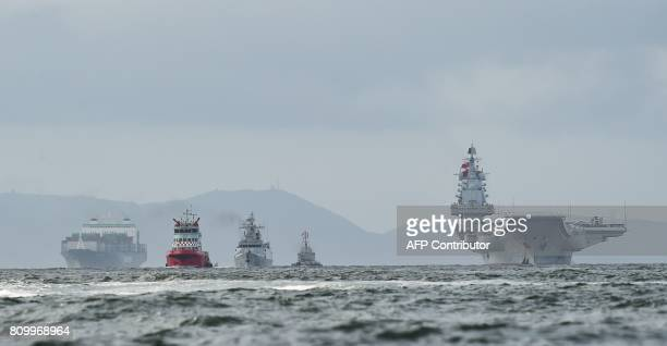 China's sole aircraft carrier, the Liaoning , arrives in Hong Kong waters on July 7 less than a week after a high-profile visit by president Xi...