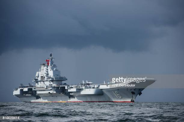 China's sole aircraft carrier the Liaoning arrives in Hong Kong waters on July 7 less than a week after a highprofile visit by Chinese President Xi...