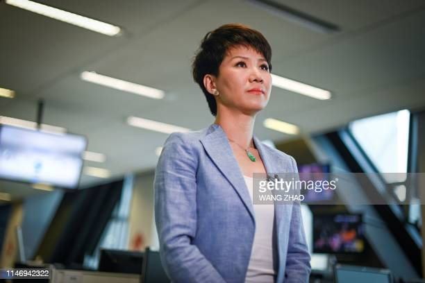 China's state broadcaster CGTN anchor Liu Xin attends an interview at the CCTV headquarters in Beijing on May 30 2019 A muchhyped war of words...