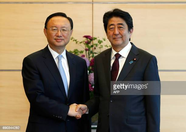 China's State Councillor Yang Jiechi meets with Japan's Prime Minister Shinzo Abe at Abe's official residence in Tokyo on May 31 2017 / AFP PHOTO /...
