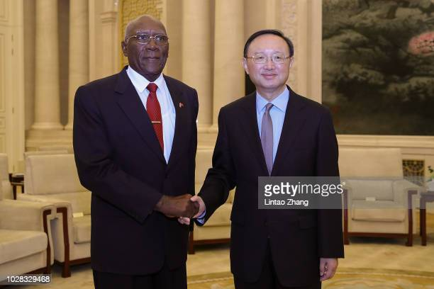 China's State Councilor Yang Jiechi shakes hands with Cuba's First Vice President Salvador Valdes Mesa at The Great Hall Of The People on September...
