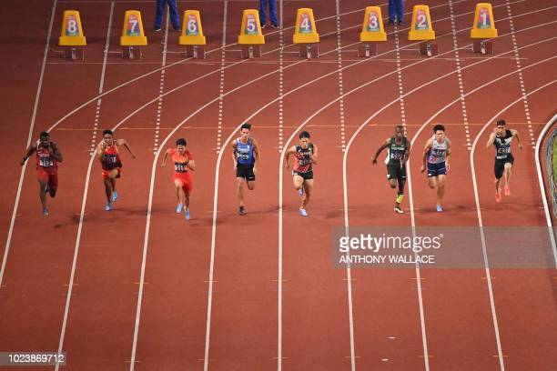 China's Su Bingtian competes in the final of the men's 100m athletics event during the 2018 Asian Games in Jakarta on August 26 2018