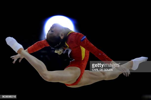 China's Sui Lu performs in the floor event in the apparatus finals during the Artistic Gymnastics World Championships 2009 at the 02 Arena in east...