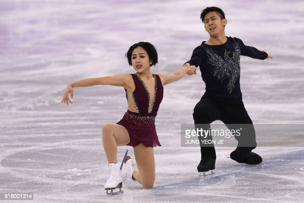 China's Sui Wenjing and China's Han Cong compete in the pair skating short program of the figure skating event during the Pyeongchang 2018 Winter...