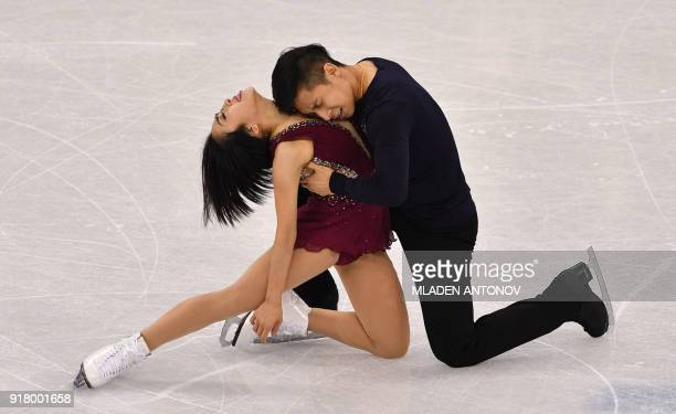 TOPSHOT China's Sui Wenjing and China's Han Cong compete in the pair skating short program of the figure skating event during the Pyeongchang 2018...