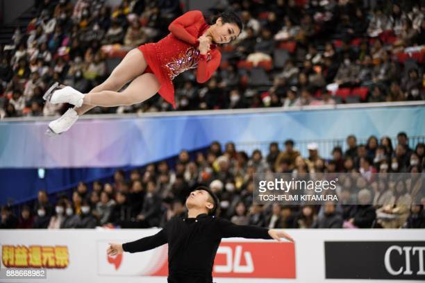 TOPSHOT China's Sui Wenjing and Han Cong compete during the pairs free skating programme at the Grand Prix of Figure Skating final in Nagoya on...