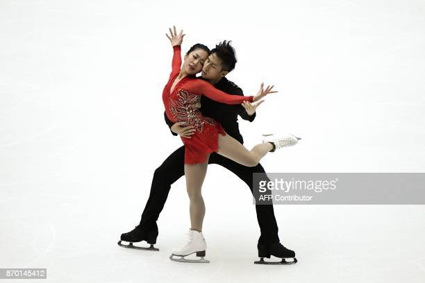 China's Sui Wenjing and Han Cong perform during the pairs free skating event of the Cup of China ISU Grand Prix of Figure Skating in Beijing on...