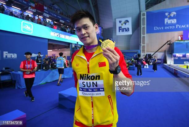 TOPSHOT China's Sun Yang poses with his gold medal after the final of the men's 200m freestyle event during the swimming competition at the 2019...
