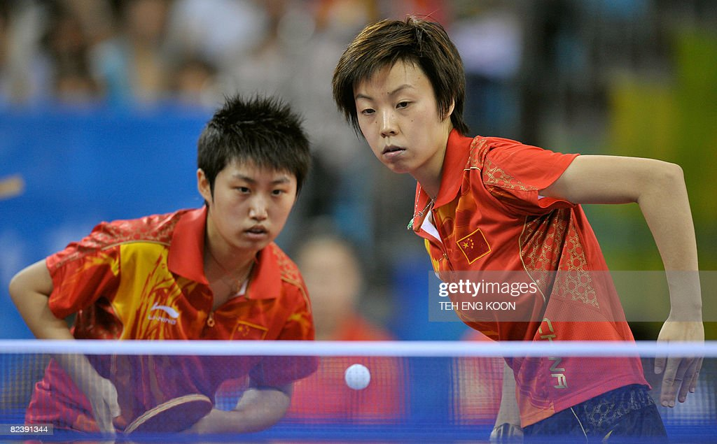 China's table tennis players Guo Yue (L) and Zhang Yining (R) play against Singapore's Wang Yue Gu and Li Jiawei during the women's team table tennis of the 2008 Beijing Olympic Games at the Peking University gymnasium in Beijing on August 17, 2008. AFP PHOTO/TEH Eng Koon
