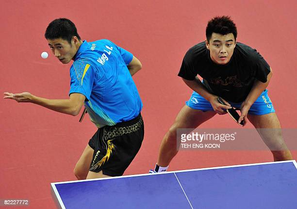 China's table tennis player's Wang Liqin and Wang Hao take part in a practice session at the Peking University Gymnasium in Beijing on August 9 2008...