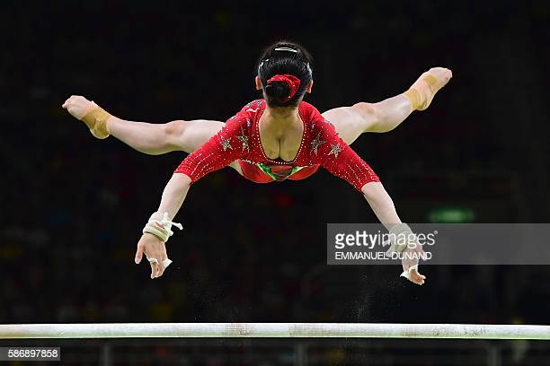 TOPSHOT China's Tan Jiaxin competes in the qualifying for the women's Uneven Bars event of the Artistic Gymnastics at the Olympic Arena during the...