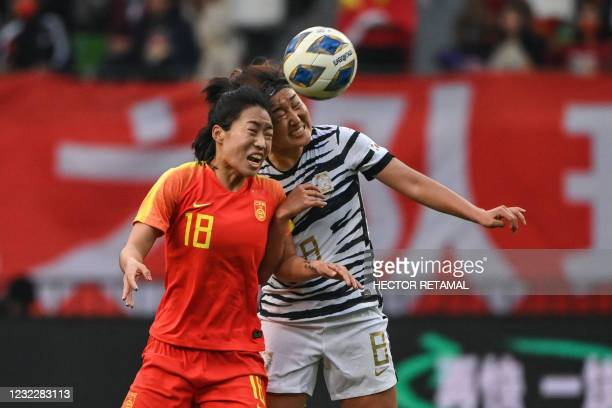 China's Tang Jiali and South Korea's Cho So-hyun compete for the ball during the qualifying play-off second leg women's football match for the Tokyo...