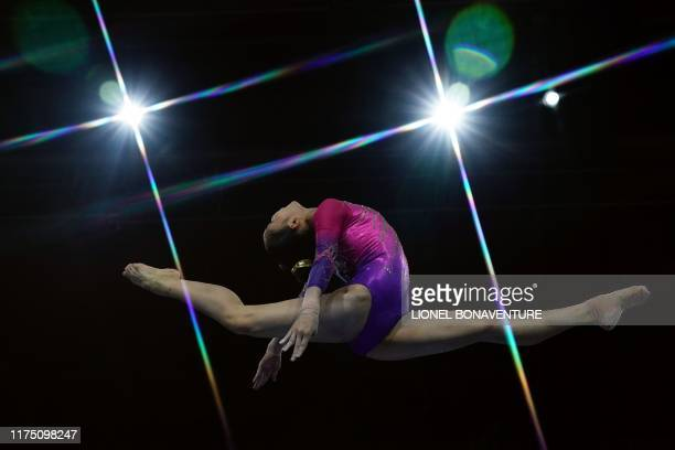 TOPSHOT China's Tang Xijing performs on the balance beam during the women's allaround final at the FIG Artistic Gymnastics World Championships at the...
