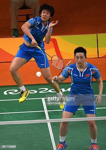 China's Tang Yuanting and China's Yu Yang returns against South Korea's Jung Kyung Eun and South Korea's Shin Seung Chan during their women's doubles...