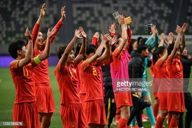 China's team celebrate their victory during the qualifying play-off second leg women's football match for the Tokyo 2020 Olympic Games between China...