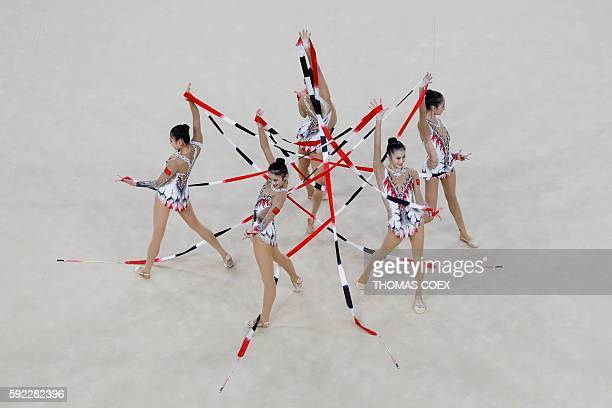 China's team compete in the group all-around qualifying event of the Rhythmic Gymnastics at the Olympic Arena during the Rio 2016 Olympic Games in...
