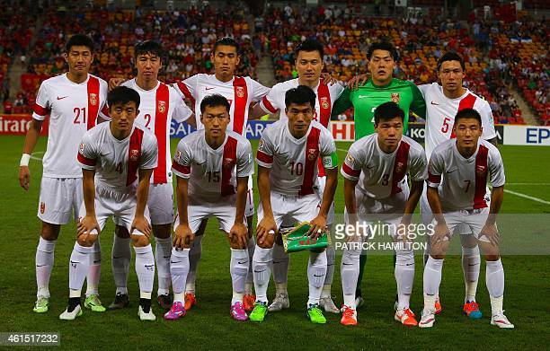China's team poses for a photo before the first round Asian Cup soccer match between China and Uzbekistan at the Suncorp Stadium in Brisbane on...
