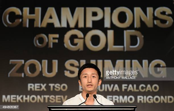 China's twotime Olympic boxing champion Zou Shiming speaks during a press conference in Macau on May 31 to promote the Champions of Gold tournament...